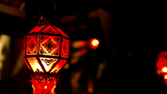 decorative garden with paper lantern at night. - paper lantern stock videos and b-roll footage
