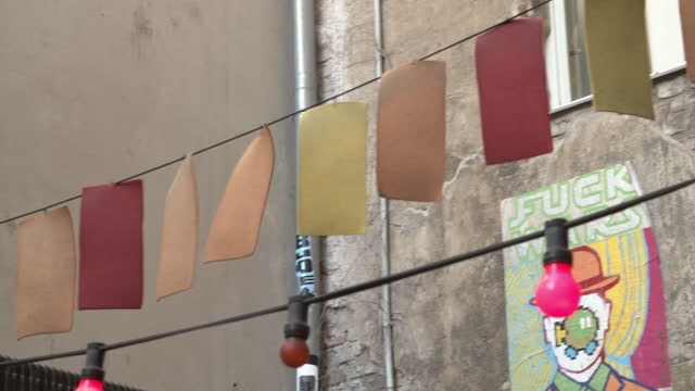 decorative light bulbs hanging in alley / berlin, germany - wall building feature stock videos & royalty-free footage