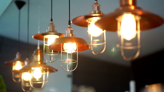decorative lighting café. abstract blurred background. - electric lamp stock videos & royalty-free footage