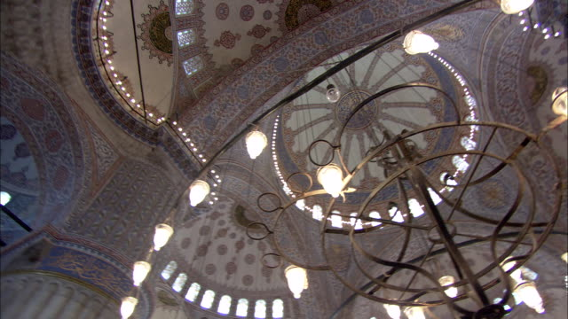 decorative lights illuminate a ceiling of blue mosque in istanbul. - istanbul province stock videos & royalty-free footage
