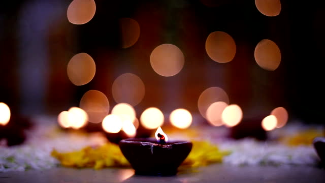 decorative oil lamp on diwali festival - oil lamp stock videos & royalty-free footage