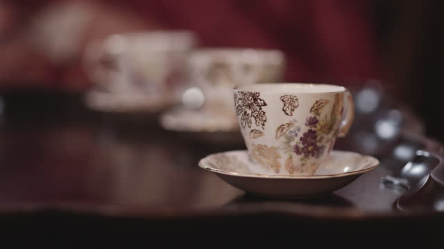 decorative porcelain tea cup and saucer. - saucer stock videos & royalty-free footage