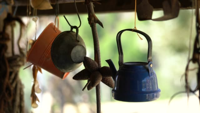 decorative retro pottery hanging at balcony - yard measurement stock videos and b-roll footage