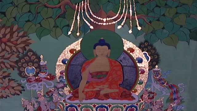 deden tsuklagkhang temple, norbulingka institute. view of a painting depicting the buddha seated beneath the bodhi tree. norbulingka was created to... - buddha stock videos & royalty-free footage