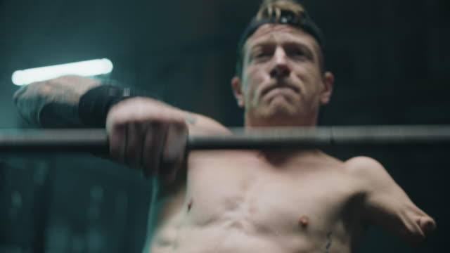 cu dedicated adaptive athlete lifts weights with one arm - shirtless stock videos & royalty-free footage