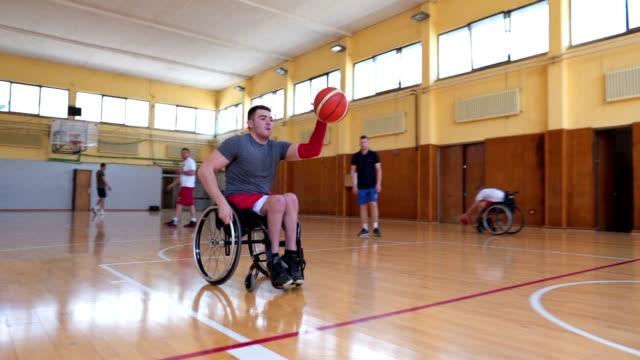 dedicated adaptive athletes training wheelchair basketball - wheelchair basketball stock videos and b-roll footage