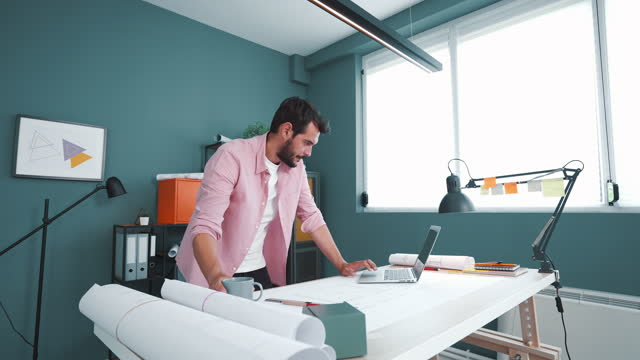 dedicated architect working from his studio. - small office stock videos & royalty-free footage