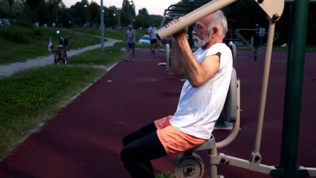 dedicated senior exercising outdoors - human limb stock videos & royalty-free footage