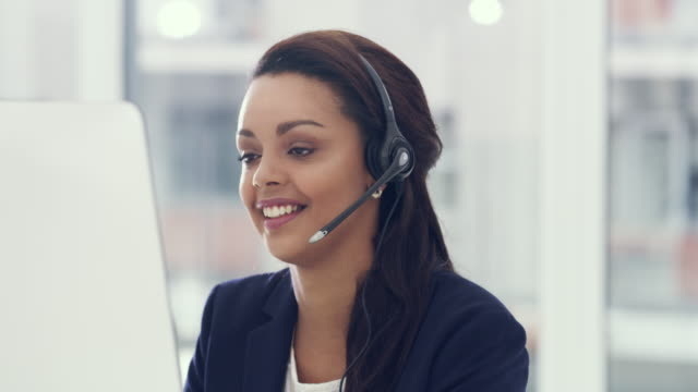 dedicated to delivering the best service to her clients - call center stock videos & royalty-free footage