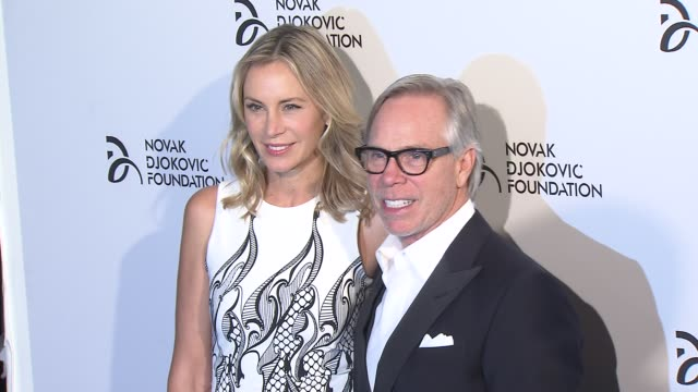 Dee Ocleppo and Tommy Hilfiger at The Novak Djokovic Foundation New York Dinner at Capitale on September 10 2013 in New York New York