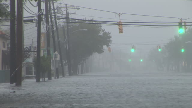 deep and fast moving storm surge inundates austin blvd in island park ny as hurricane irene makes landfall in the new york city area - storm surge stock videos & royalty-free footage