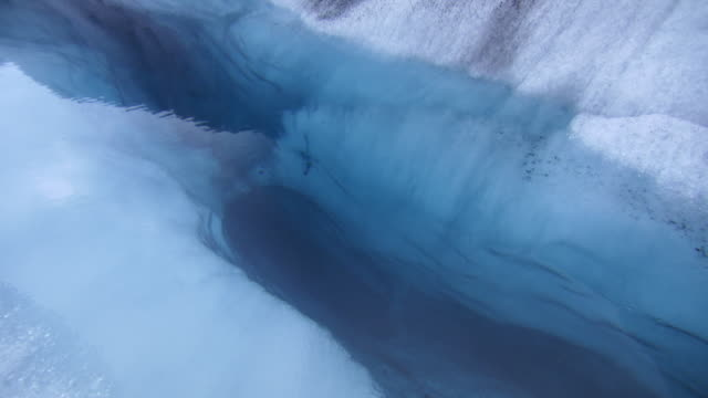 A deep crevice in Nigardsbreen glacier formed by meltwater