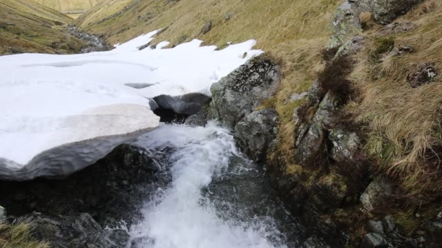 deep drifted snow in a ravine above dunmail in the lake district, uk. - gill stock videos & royalty-free footage