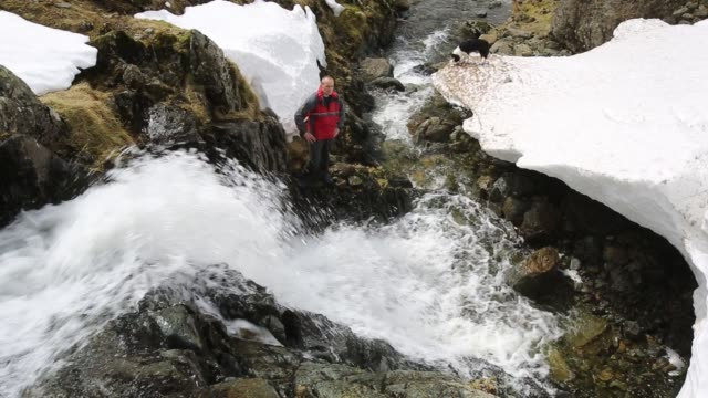 deep drifted snow in a ravine above dunmail in the lake district, uk. - falling water stock videos & royalty-free footage