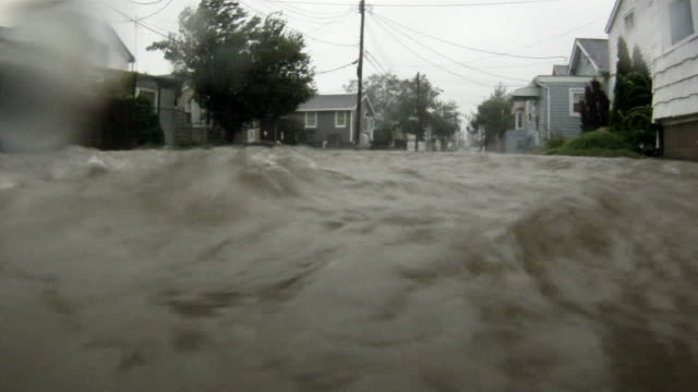 deep flood waters inundate homes on a residential street in the town of broad channel ny as hurricane irene makes land fall in the new york city area - storm surge stock videos & royalty-free footage