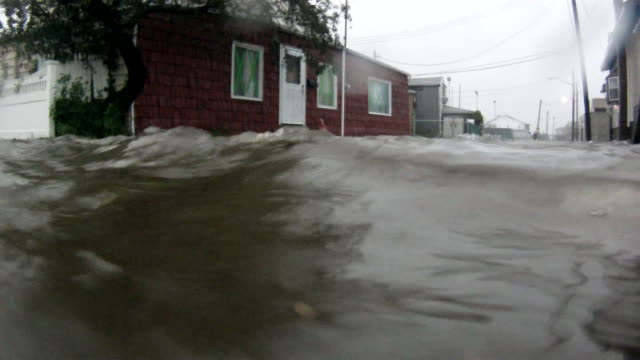 deep flood waters inundate homes on a residential street in the town of broad channel, ny as hurricane irene makes land fall in the new york city... - hurricane irene stock videos & royalty-free footage