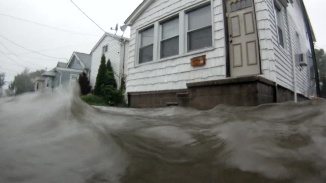 deep flood waters surround homes on a residential street in the town of broad channel, ny as hurricane irene makes land fall in the new york city... - hurricane irene stock videos & royalty-free footage