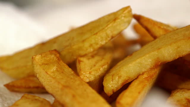 deep fried chips on napkin - less than 10 seconds stock videos & royalty-free footage