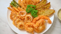 deep fried seafood (shrimps and squid) with mix vegetable