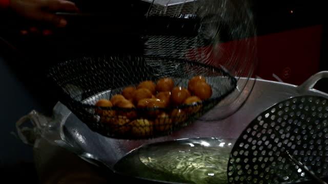 deep fried sweet potato balls - fried potato stock videos and b-roll footage