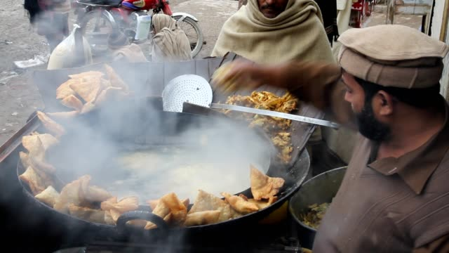 deep frying pakora and samosa (snack) - punjab pakistan stock videos & royalty-free footage