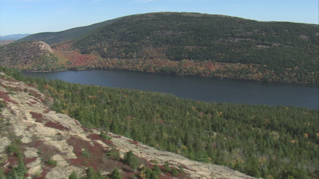 aerial deep inlet with surrounding hills in fall colors / maine, united states - inlet stock videos & royalty-free footage