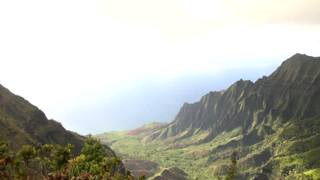 deep kauai island valley extending to edge of ocean - butte rocky outcrop stock videos & royalty-free footage