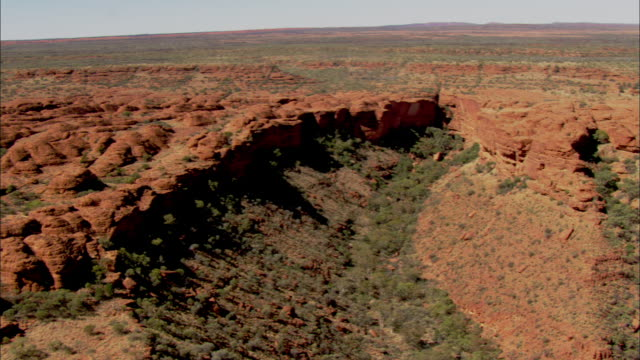 deep ravines lie beneath sandstone domes in kings canyon. - northern territory australia stock videos & royalty-free footage