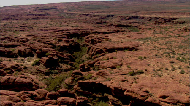 deep ravines wind through the sandstone domes of kings canyon. - northern territory australia stock videos & royalty-free footage