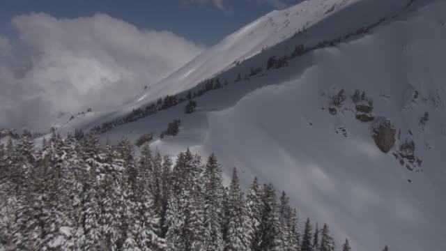 Deep snow blankets high ridges and slopes in the Wasatch Mountains.