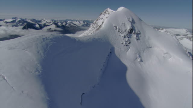 Deep snow blankets summits in the Austrian Alps. Available in HD.