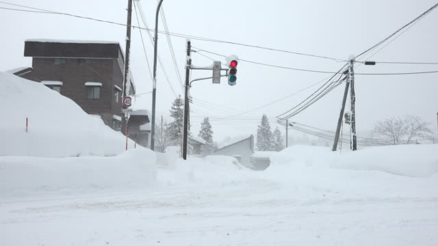 Deep snow buries town in Japan's famed snow country on the Sea of Japan side of Honshu