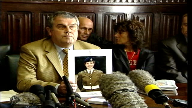 Deaths LIB PHOTOGRAPHY*** Parents of soldiers who died at Deepcut holding up photographs of children at press conference