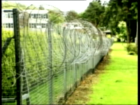 relatives see police report lib england surrey deepcut razor wire fence around barracks / soldiers training - barracks stock videos and b-roll footage