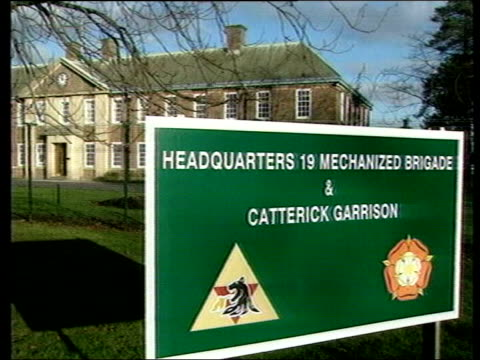 army criticised lib surrey ext sign at barracks 'catterick garrison' barbed wire on fence gv platoon of soldiers marching - barracks stock videos & royalty-free footage