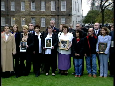 no evidence of foul play lib london westminster parents holding still photographs of dead soldiers zoom out to parents and relatives gathered in... - barracks stock videos & royalty-free footage