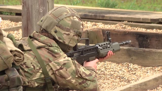 deepcut barracks women soldiers training and on parade; england: surrey: deepcut barracks: ext general views women soldiers at firing range at... - army stock videos & royalty-free footage