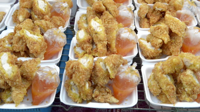 Deep-fried Chicken with souce for take away in a food stall