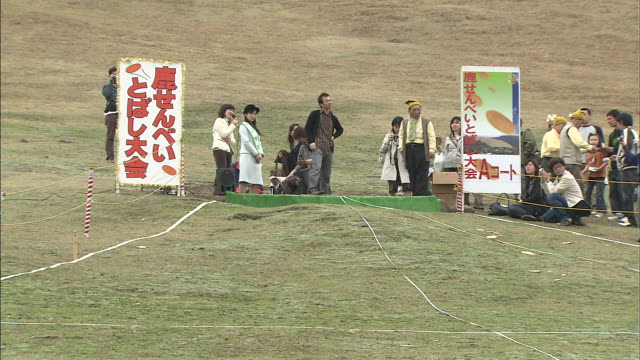 deer-cracker throwing contest / mt. wakakusa - cracker stock videos and b-roll footage