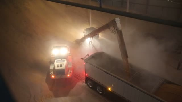 a deere co auger tractor loads a semi truck with corn inside a storage facility at michlig grain llc in sheffield illinois us on thursday march 24... - sheffield stock videos and b-roll footage