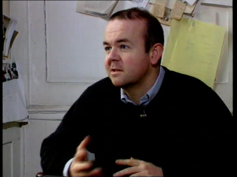 defamation bill introduced; carlisle st tlms ian hislop sitting at desk working cms ian hislop intvwd sot - will mean lawyers can milk the system... - ian hislop stock videos & royalty-free footage