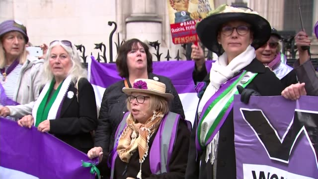 defeat for women in state pension age high court challenge; england: london: westminster: the royal courts of justice: ext protesters holding banner... - pension stock videos & royalty-free footage