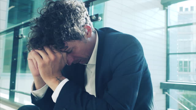 defeated and stressed businessman. - loss stock videos & royalty-free footage