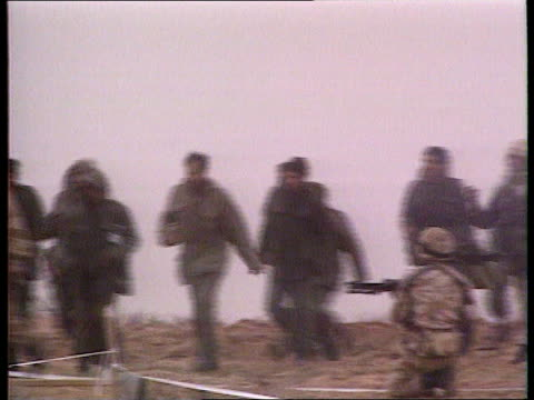 regiments rebellion southern ms scottish borderers with iraqi pows pan tx27291 r uk ms soldiers treating wounded iraqi ms iraqi pow being searched - prisoner of war stock videos & royalty-free footage