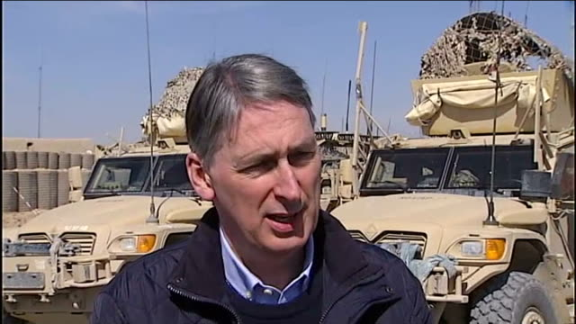 defence secretary philip hammond visits camp bastion; afghanistan: camp bastion: ext philip hammond mp interview sot - re how are things progressing... - international security assistance force stock videos & royalty-free footage
