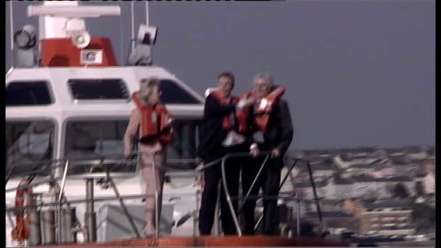stockvideo's en b-roll-footage met defence secretary takes responsibility for allowing released sailors to sell stories wales pembrokeshire milford haven harbour ext tony blair mp... - pembrokeshire