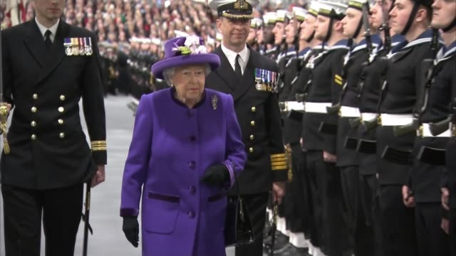 defence select committee warning over overstretched budget; lib / england: hampshire: portsmouth: hms queen elizabeth: int queen elizabeth ii... - royal marines stock videos & royalty-free footage