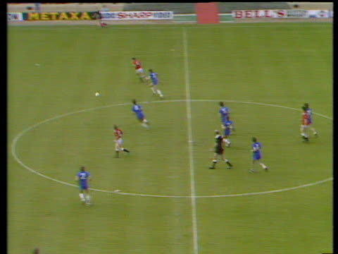 defence splitting pass from mark hughes finds norman whiteside wide on rightwing whiteside surges into box cuts inside and curls winning goal around... - 1985 stock-videos und b-roll-filmmaterial