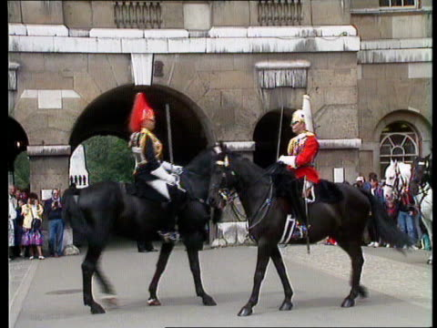 force cuts; f)naf england: london: horse guards parade mounted line of cavalry towards cms two mounted cavalrymen bv line of cavalrymen cms side... - cavalry stock videos & royalty-free footage