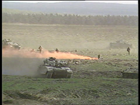 defence white paper - force cuts; w.germany: sennelager: tgv tanks advancing l-r over open ground during manoeuvres zoom in tlms ditto with orange... - white点の映像素材/bロール